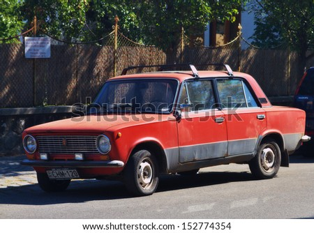 VISEGRAD, HUNGARY-18 AUGUST: Old Soviet car VAZ-2101 Zhiguli on August 18, 2013 in Visegrad.The VAZ-2101 is a compact sedan car produced by AvtoVAZ and introduced in 1970.It had a 1.2L 58 HP engine. - stock photo