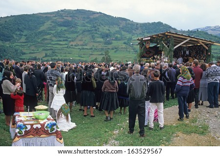 VISEU DE JOS, MARAMURES, ROMANIA - AUGUST 27: people in traditional clothing at orthodox event on August 27, 2000 in Viseu de Jos, Maramures, Romania. Events are important part of Romanian culture.