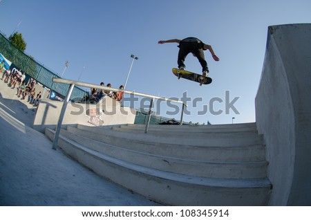 VISEU, PORTUGAL - JULY 22: Ruben Rodrigues over the stairs at DC Skate challenge by MEO on july 22, 2012 in Viseu, Portugal.