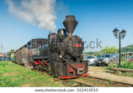 VISEUL DE SUS, ROMANIA - AUGUST 10, 2015: Mocanita the touristic train, the main touristic atraction in Maramures County waiting for departure signal at train station - stock photo