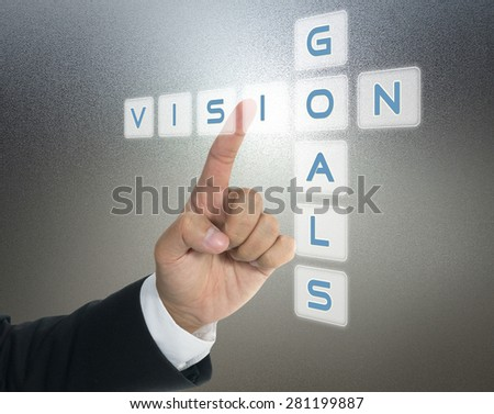 vision and goals with hand of business man