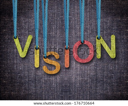 Vision Letters hanging strings with blue sackcloth background. - stock photo