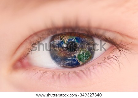 Vision of Planet Earth inside a child's eye - stock photo