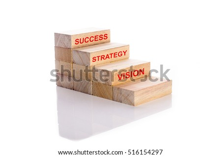 Vision, strategy and success words on wooden cubes stack. Step to success in business concept