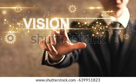 Vision text with businessman on dark vintage background