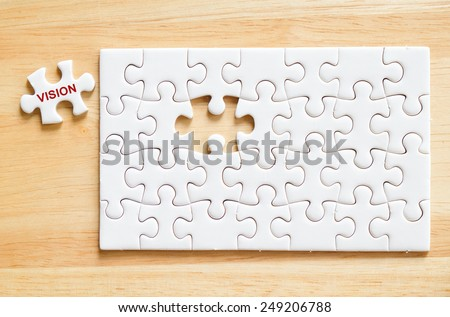 Vision word on jigsaw puzzle piece,business concept background - stock photo