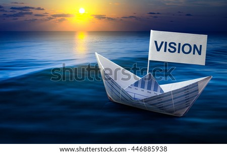 Vision word with boat made from business paper graph on sea and sun light.For business vision concept and financial concept ideas. - stock photo
