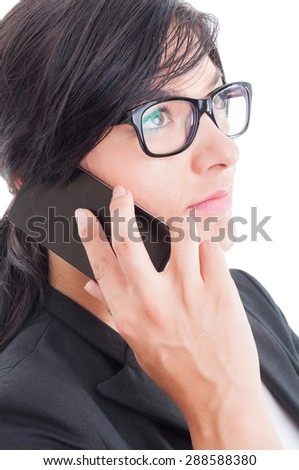Visionary business woman or saleswoman talking on smartphone