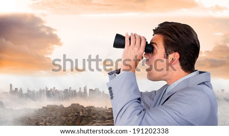 Visionary businessman looking to the future against misty landscape - stock photo
