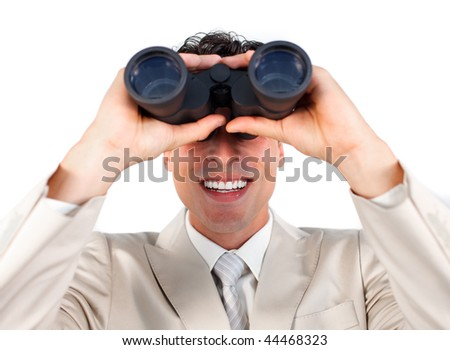 Visionary businessman predicting future success through binoculars - stock photo