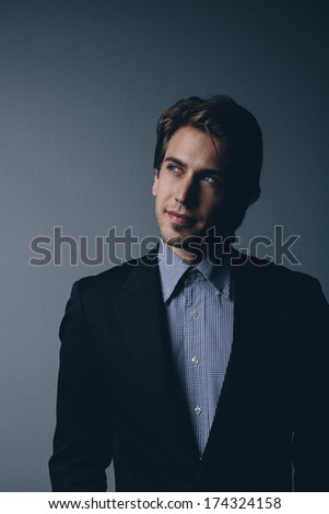 Visionary businessman standing thinking as he gives his imagination free reign in order to come up with innovative business ideas or strategy - stock photo