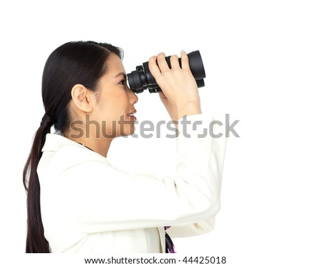 Visionary businesswoman looking through binoculars isolated on a white background - stock photo