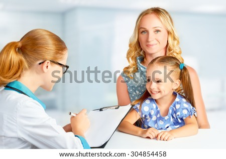 visit mother and child to the doctor pediatrician - stock photo