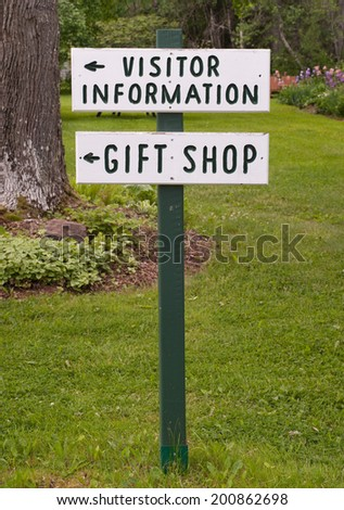 Visitor information and gift shop sign in rural setting.