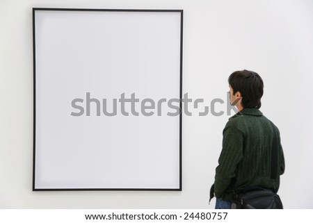 Visitor looks on frame - stock photo