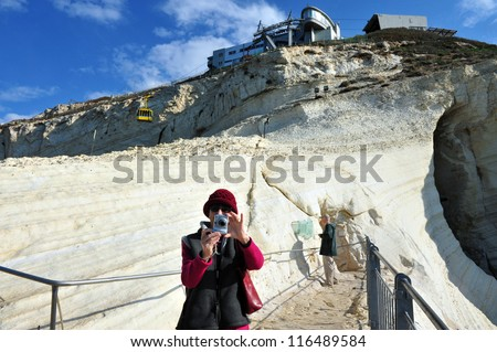 Visitors at Rosh HaNikra grottoes that located  between Israel and Lebanon border in North Israel. - stock photo