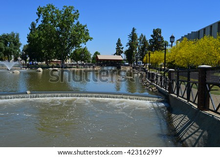 Visitors to Bakersfield, California's Central Park benefit from the use of agricultural irrigation water as it passes through.