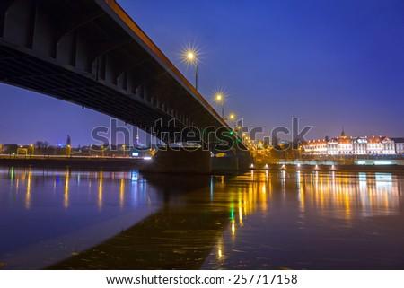 Vistula river scenery with bridge and Royal Castle in Warsaw, Poland - stock photo