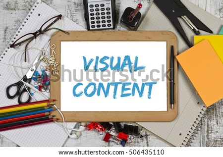 Visual content written on a bulletin board with pencils and note pad
