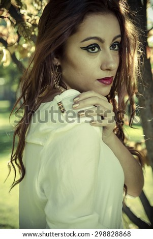 Vitality, beautiful woman in a forest, redhead with long hair - stock photo