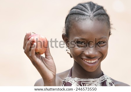 Vitality Healthy Eating Symbol: Smiling Young African Ethnicity Girl Apple - stock photo