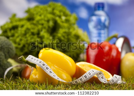 Vitamin and Fitness diet, dumbell in green grass