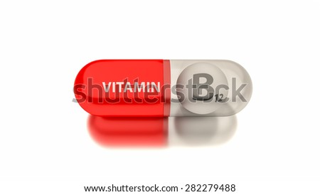 Vitamin B12 in red capsule. Conceptual image for health concepts. - stock photo