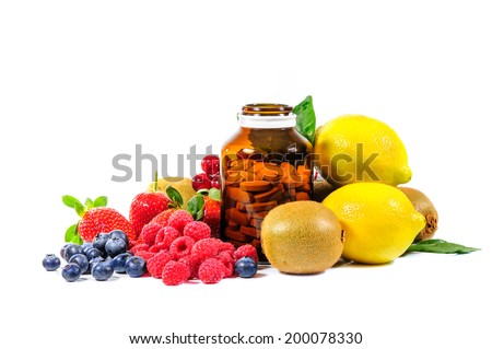 Vitamin C and mix fruit on white background - stock photo