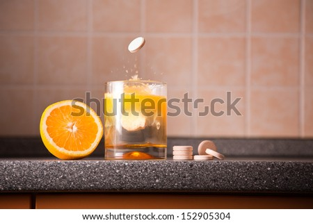 Vitamin C healthy lifestyle concept �¢?? orange, tablet stack, dissolving tablet  - stock photo
