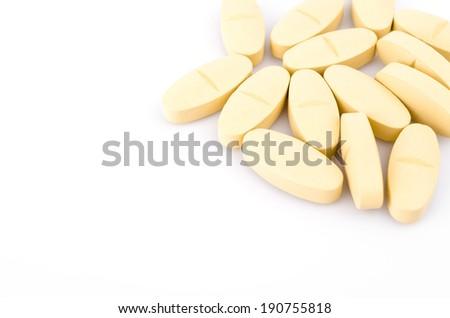 Vitamin C pills on white background - stock photo