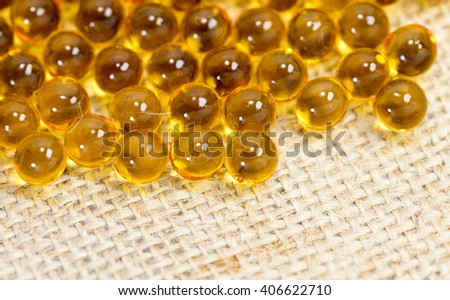 vitamin cod liver oil on a background of brown fabric