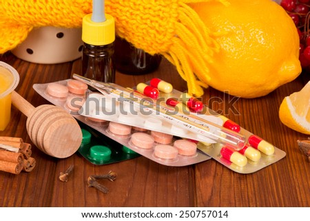 Vitamin concept - close up of lemon and pills - stock photo