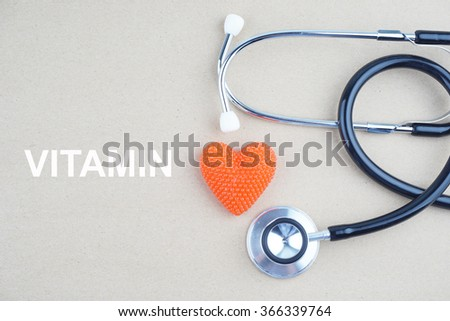 VITAMIN concept with stethoscope and heart shape  - stock photo