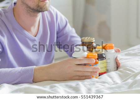 Vitamin, drags, pills and tablets in hand
