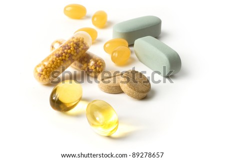 Vitamin herbal medicine pills/ tablets / capsules isolated on white background  with shadows - stock photo