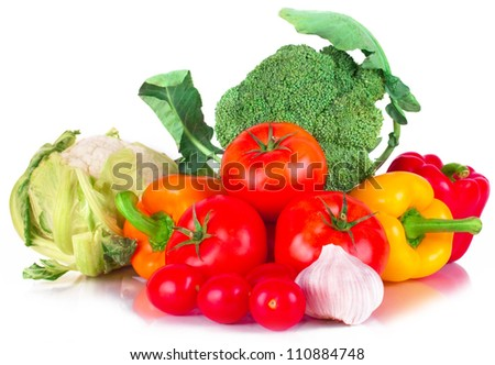 vitamin set of vegetables from the  large broccoli green leaves red ripe tomatoes, orange and yellow peppers and purple garlic with green sprigs of fresh isolated on white background - stock photo