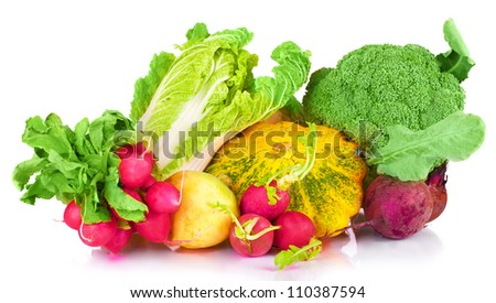 vitamin set of vegetables from the  large turnip, beets, zucchini orange and yellow with green sprigs radish bright and fresh green salad leaves of fresh isolated on white background - stock photo