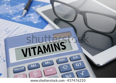 VITAMINS Calculator  on table with Office Supplies. ipad
