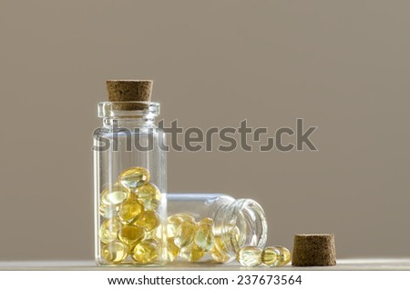 Vitamins in a glass containers on a display table - stock photo