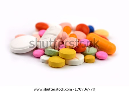 vitamins, pills and tablets on a white background