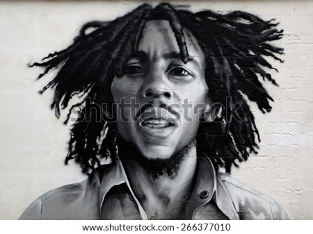 VITEBSK, BELARUS - NOVEMBER 26: Graffiti portrait of Bob Marley, a famous Jamaican reggae singer-songwriter and guitarist on november 26, 2014 in Vitebsk, Belarus - stock photo