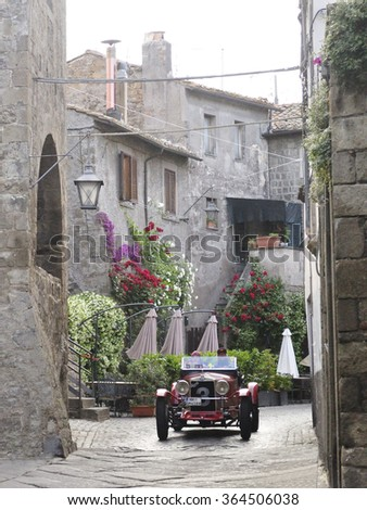 VITERBO (VT), ITALY - MAY 16: A red OM 665 Superba SSMM takes part to the 1000 Miglia classic car race on May 16, 2015 in Viterbo (VT). The car was built in 1930. - stock photo