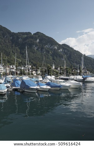 VITZNAU, LAKE LUCERNE, SWITZERLAND - AUGUST 2016: Vitznau marina harbor with sail yachts on Lake Lucerne.