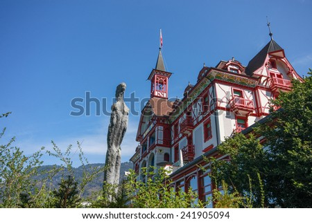 VITZNAU, SWITZERLAND - APRIL 20, 2014:  Hotel Vitznauerhof at mount Rigi foothills and shore of  lake Lucerne in Vitznau on April 20, 2014. It's a starting point for excursions around the lake  - stock photo