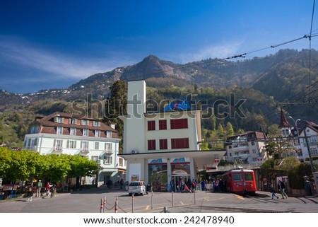 VITZNAU, SWITZERLAND - APRIL 20, 2014:  Railway station for trip from lake Lucerne shore to mount Rigi in Vitznau on April 20, 2014. Rigi railway is the Europe's oldest mountain railways  - stock photo