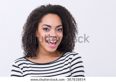 Vivacious mulatto woman smiling - stock photo