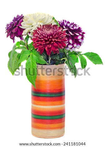 Vivid colored vase with chrysanthemum and dhalia purple flowers, isolated, white background. - stock photo