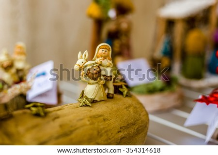 vivid colors of a Christmas Nativity scene, the Blessed Virgin Mary and Saint Joseph travelling to Egypt - stock photo