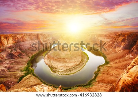 Vivid dramatic sunset over Horseshoe Bend, a famous meander on river Colorado near the town of Page. Arizona, USA - stock photo