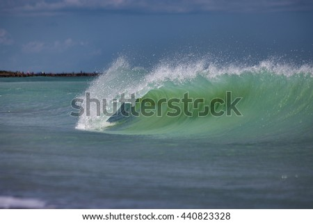 Vivid Florida tropical waves rolling into the beach waters.